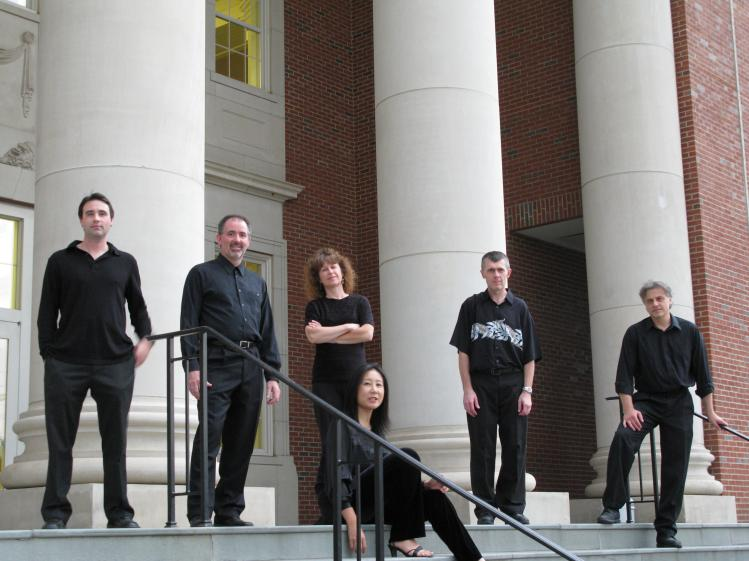 OBE founding members and guest performers after a concert in Charlotte, NC. Left to right: Leonard Mark Lewis, Ronald Keith Parks, Judy Meister, Geoff Whitehead, Craig Bove, Tomoko Deguchi (seated).